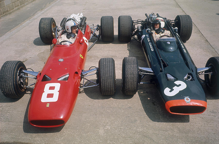 Chris Amon And Jackie Stewart At The Photograph by Heritage Images
