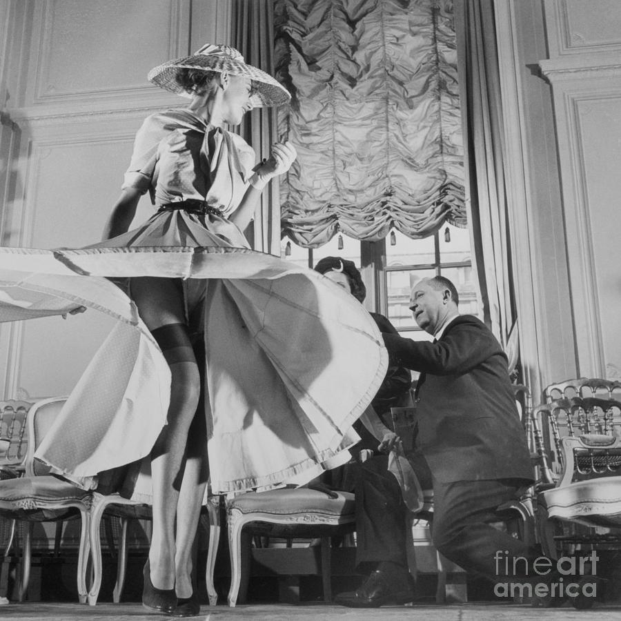 Christian Dior With Woman Modeling Photograph by Bettmann
