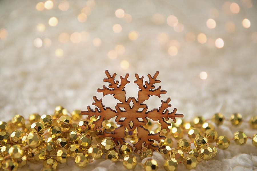 Christmas Lights And Snowflake Photograph