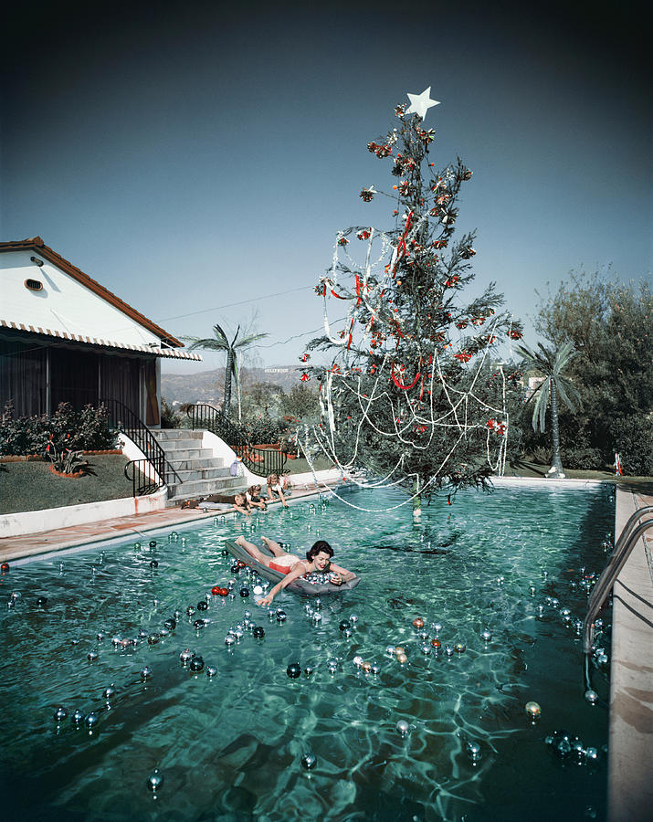Christmas Swim Photograph by Slim Aarons