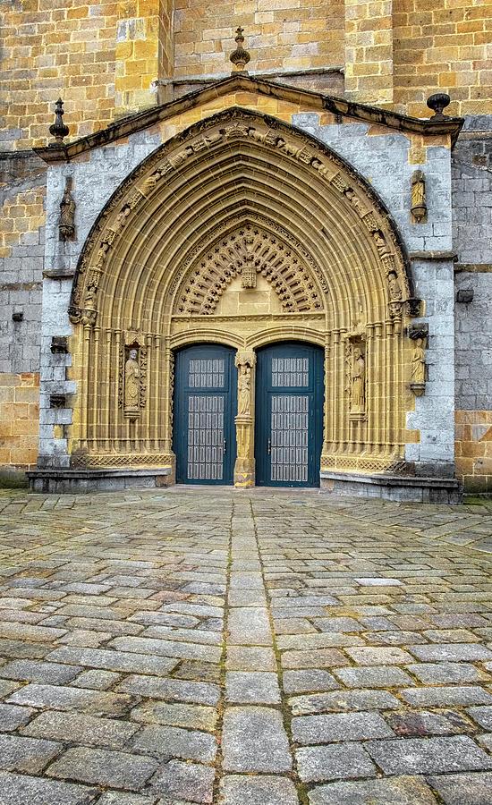 Church Doors In Guernica by Tom Singleton