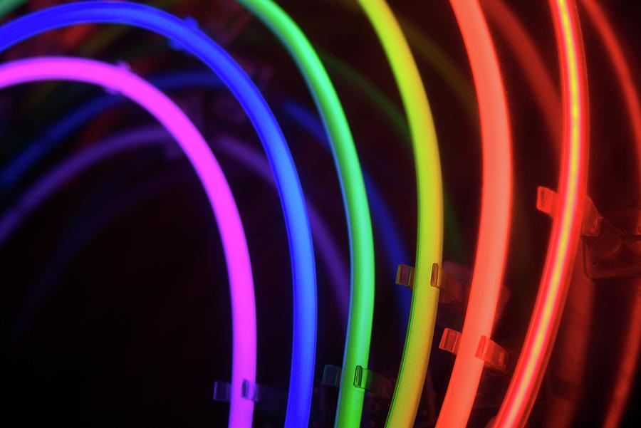 Circles Of Neon Rainbow Light Photograph by Peskymonkey