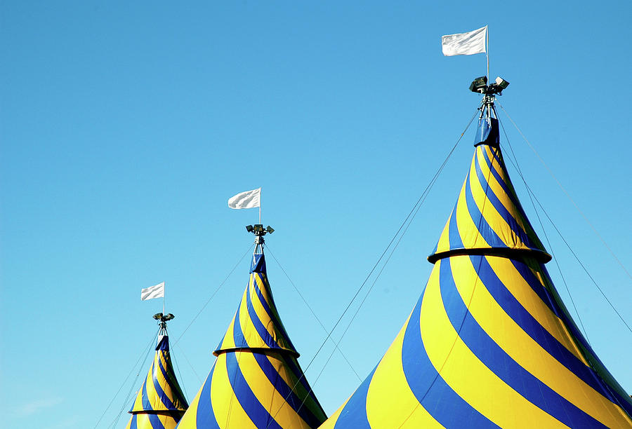 Circus Tents Against Blue Sky Photograph by Photo By Christopher Hall