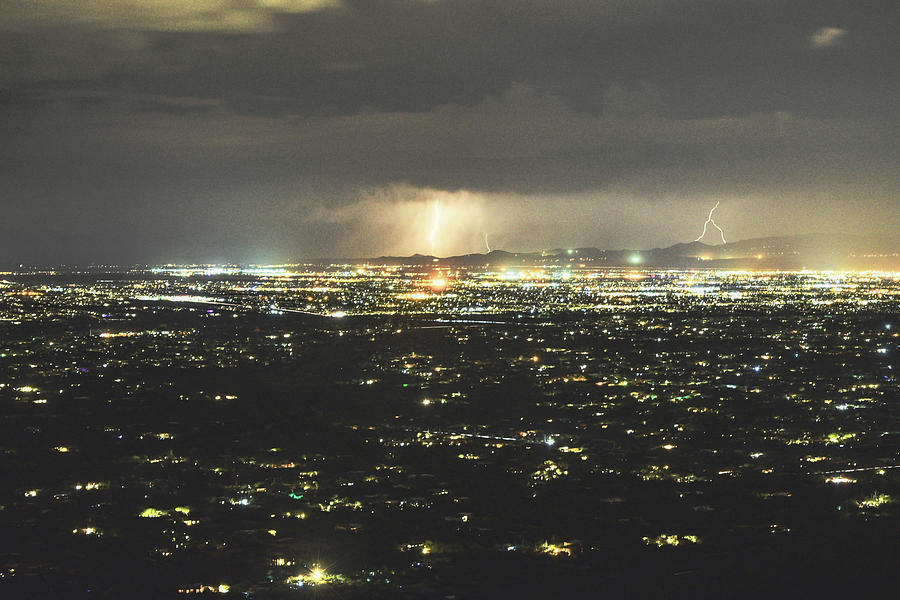 City lights of Tucson and Lightning Storm by Chance Kafka