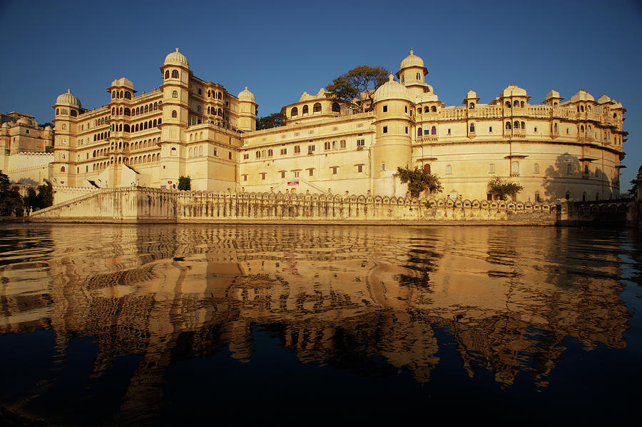 City Palace And Lake In Udaipur Photograph by Win-initiative