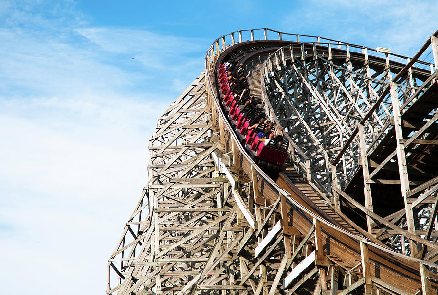 Classic Roller Coaster With People At Photograph by Awelshlad