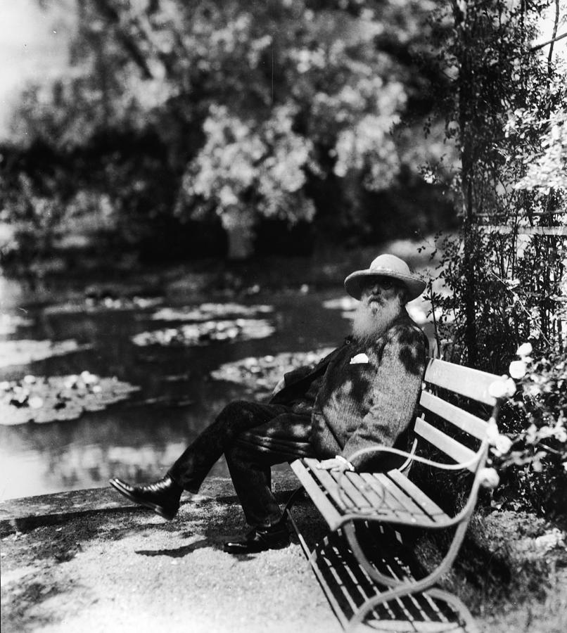 Casual Clothing Photograph - Claude Monet Sitting On Park Bench by Hulton Archive