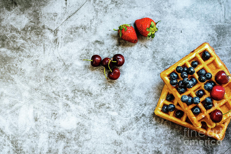 Clean background with a lot of negative space for healthy food, with red fruits and waffle. by Joaquin Corbalan
