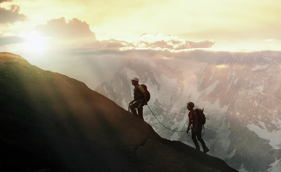 Climbers On A Mountain Ridge Photograph by Buena Vista Images