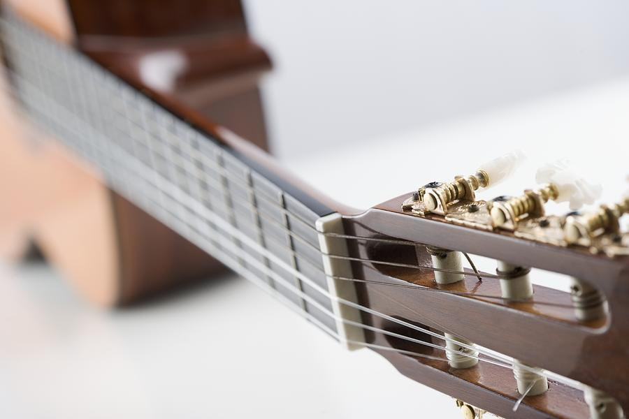 Close-up Of A Guitar Photograph by Jamie Grill