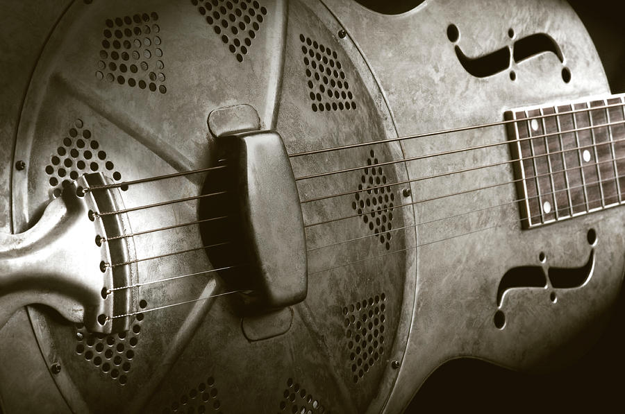 Close-up Of A Resonator Guitar In Sepia Photograph by Bns124