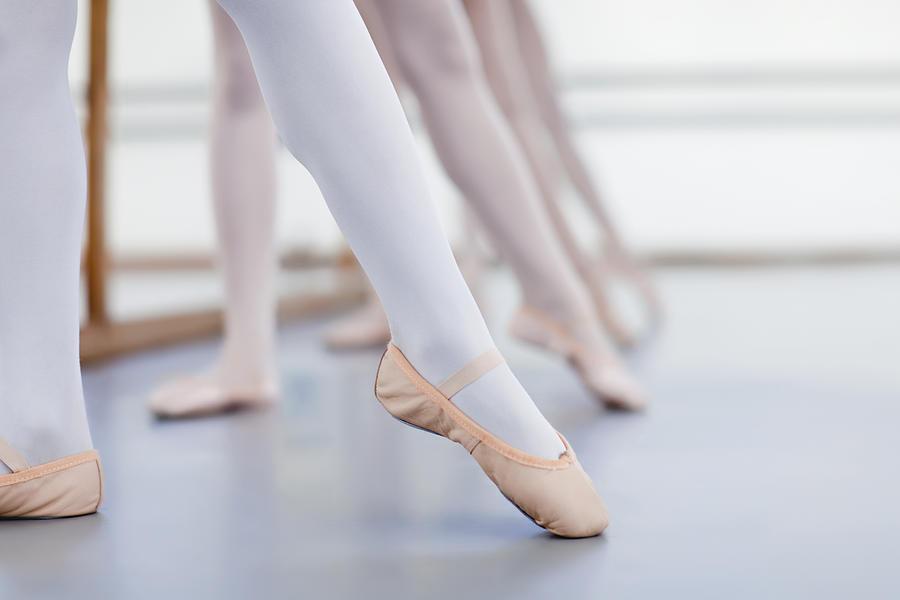 Close Up Of Ballet DancersÍ Feet Photograph by Hybrid Images