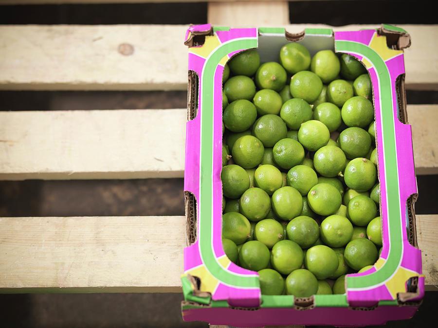 Close Up Of Box Of Limes Photograph by Monty Rakusen