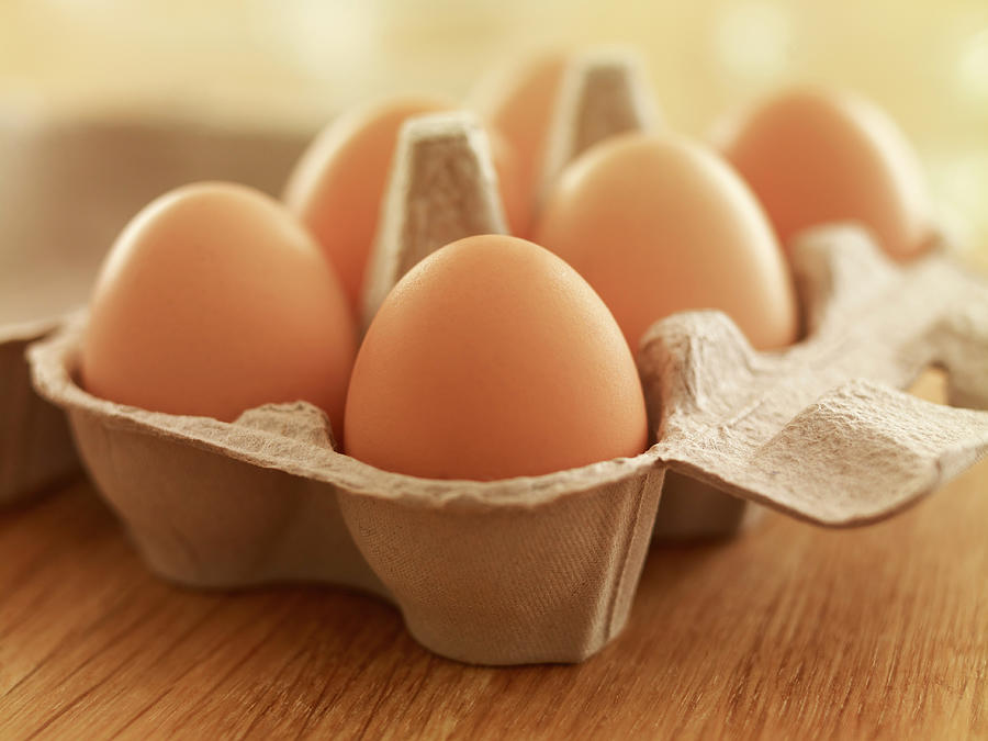 Close Up Of Brown Eggs In Carton Photograph by Adam Gault