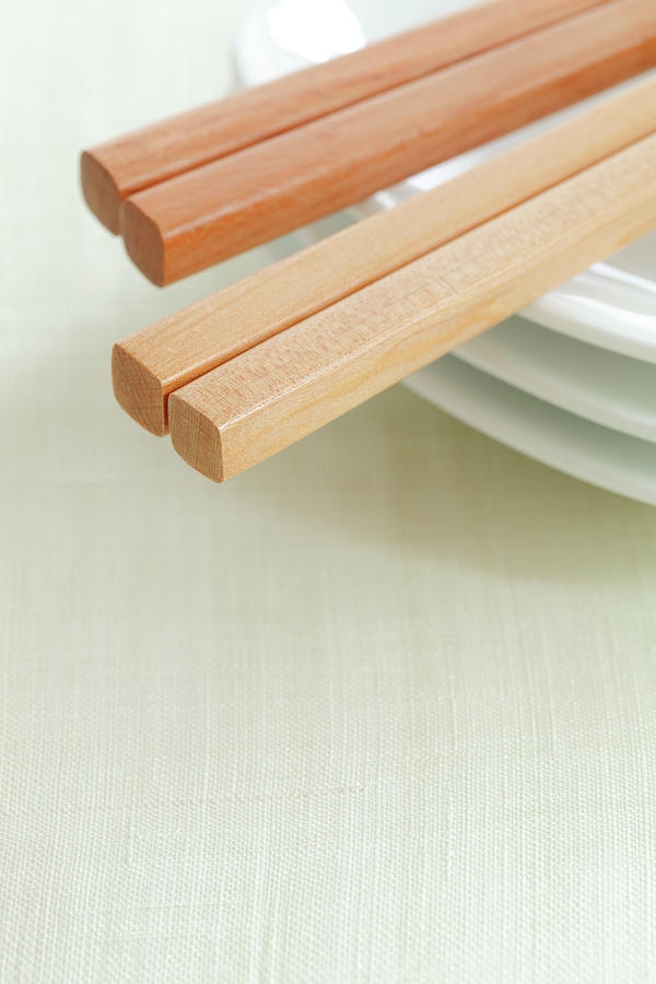 Close-up Of Chopsticks On Plate Photograph by Imagewerks