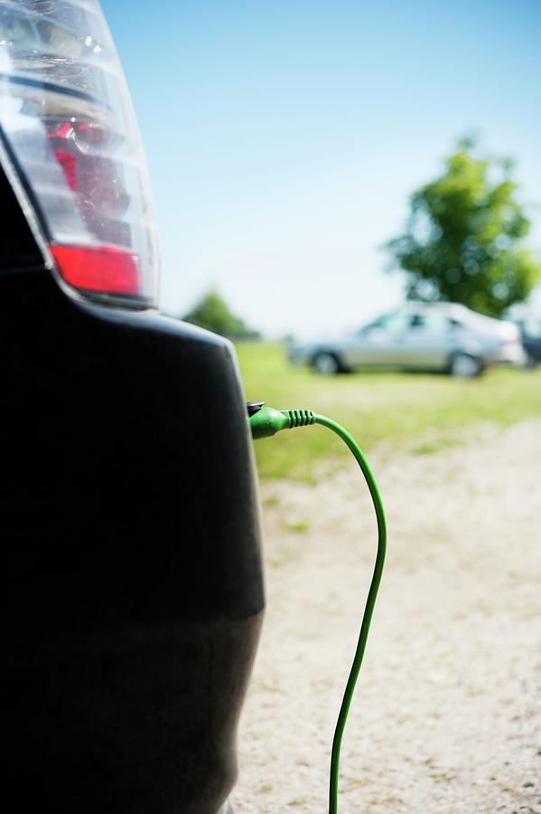 Close Up Of Electric Car Charging Photograph by Johner Images