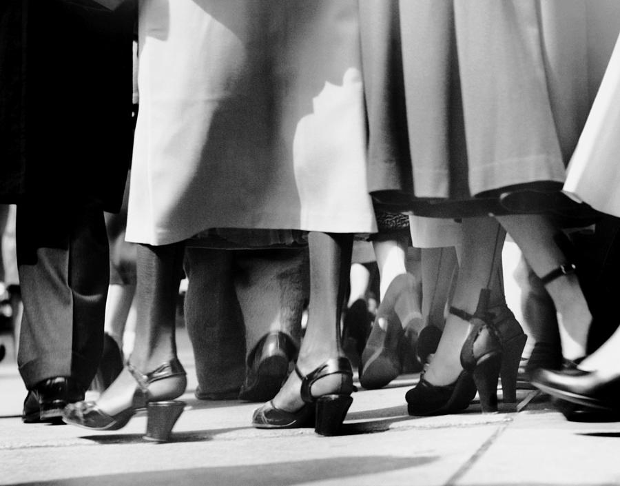 Close-up Of Feet Walking On Sidewalk Photograph by George Marks