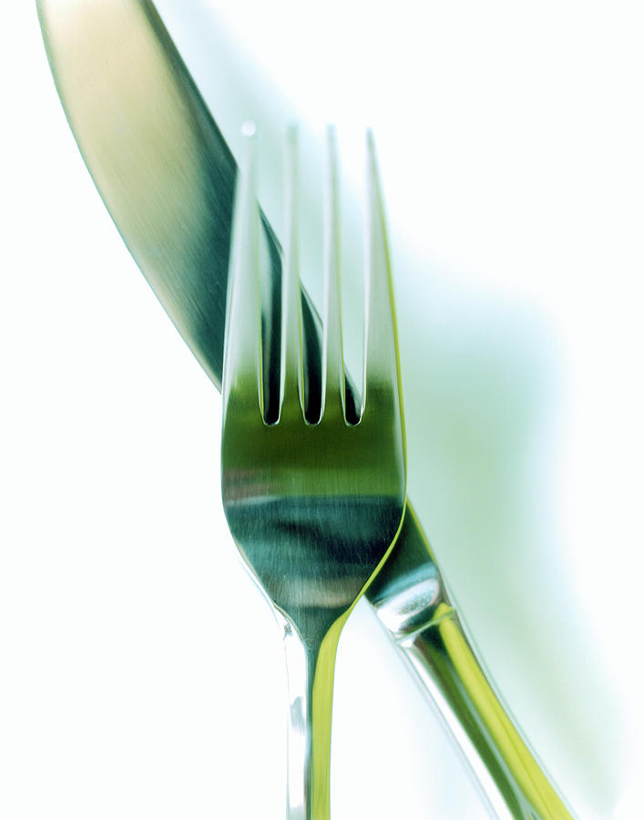 Close-up Of Fork And Knife On White Photograph by Amy Neunsinger