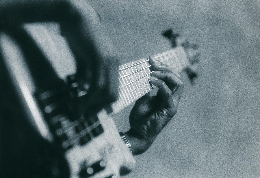 Close-up Of Guitar Fingering Photograph by Digital Vision.