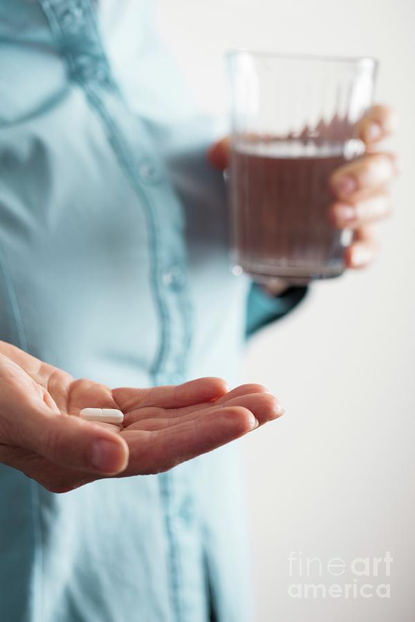 Copy Space Photograph - Close-up Of Hand With A Pill And Glass Of Water by Cristina Pedrazzini/science Photo Library