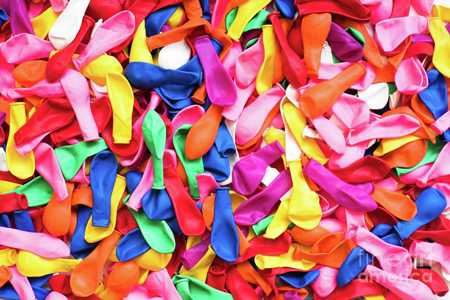 Close-up of many colorful children's balloons, background for mo by Joaquin Corbalan