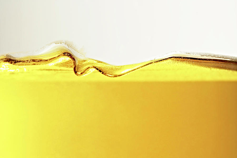 Close Up Of Oil In Glass Photograph by Cwp