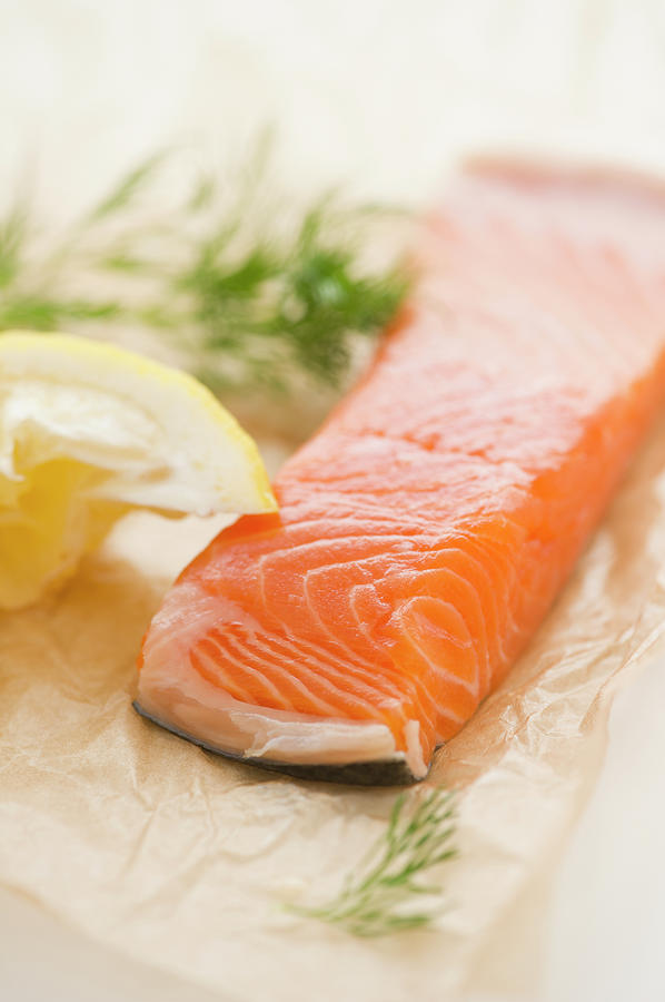 Close Up Of Salmon Meat With Lemon And Photograph by Jamie Grill