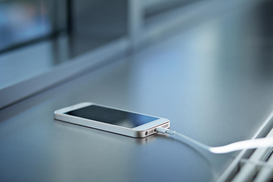 Close-up Of Smartphone Charging Photograph by Klaus Vedfelt