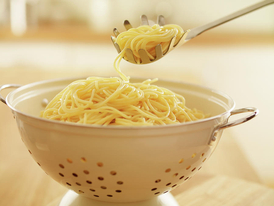 Close Up Of Spoon Scooping Spaghetti In Photograph by Adam Gault