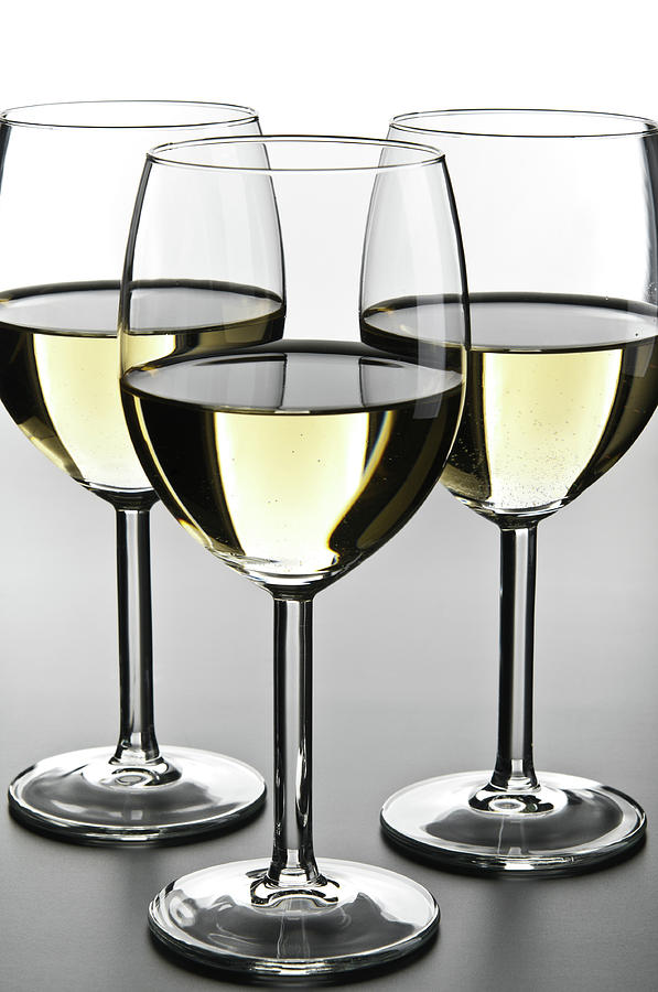 Close-up Of Three White Wine Glasses Photograph by Domin domin