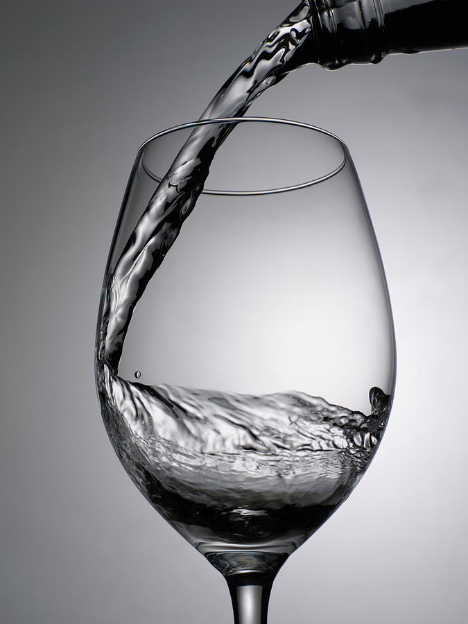 Close Up Of Wine Being Poured Into Wine Photograph by Johner Images