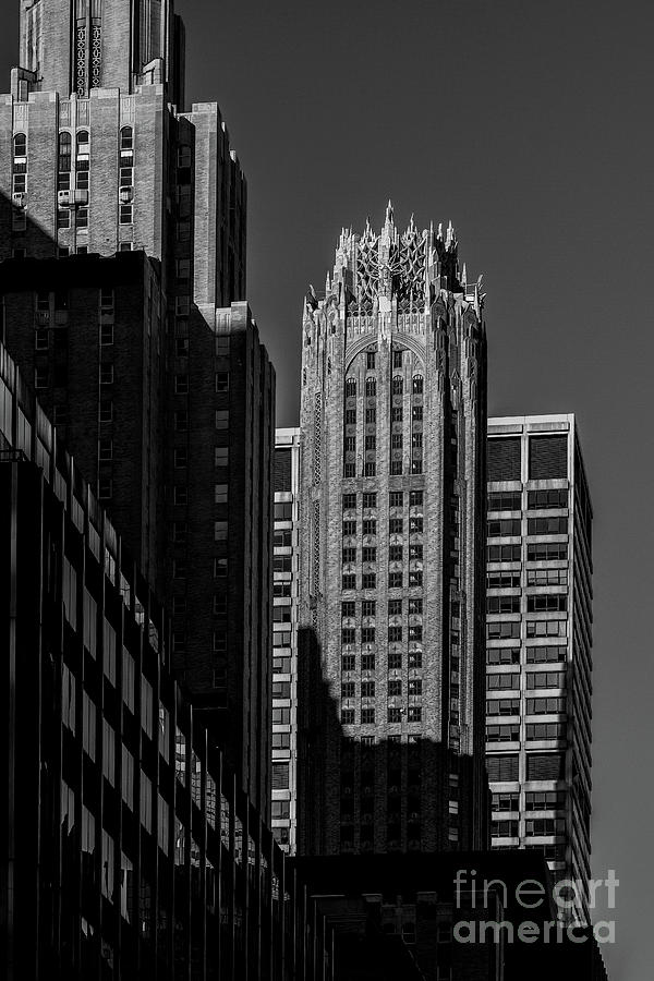 Close-up view of General Electric Building and modern skyscraper by Edi Chen