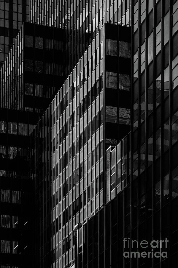 Close-up view of  modern skyscrapers exterior in Midtown Manhatt by Edi Chen