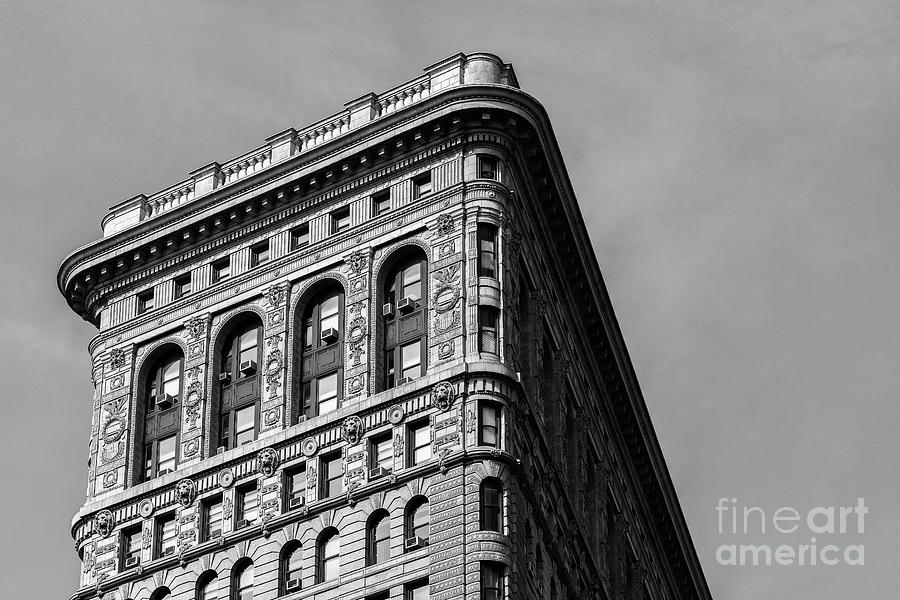 Close view of ornament on the building exterior of Flatiron Buil by Edi Chen