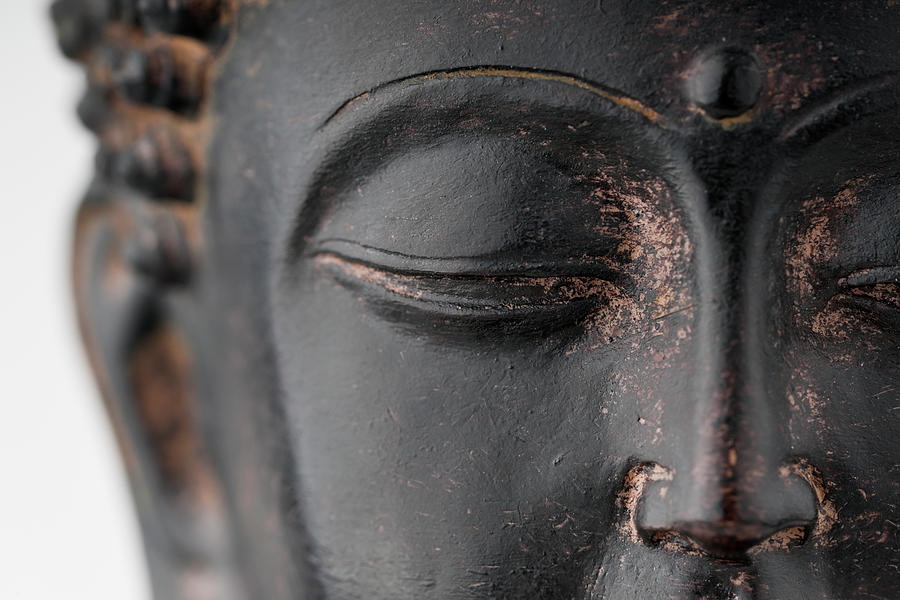 Closeup Of Black Stone Buddha Face Photograph by Wesvandinter