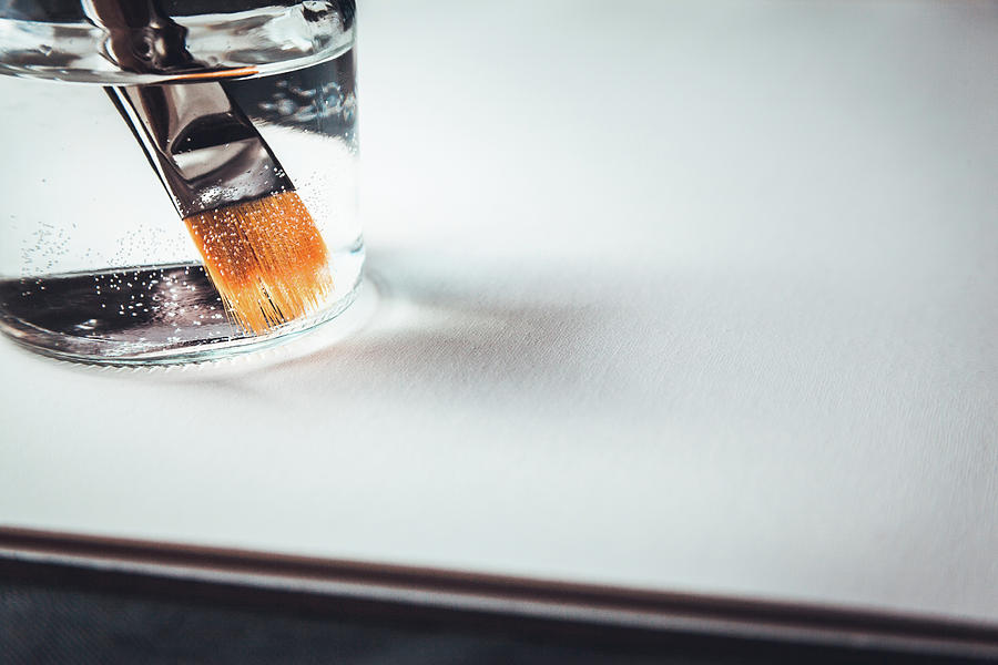 Closeup of Paintbrush In Water by Jeanette Fellows
