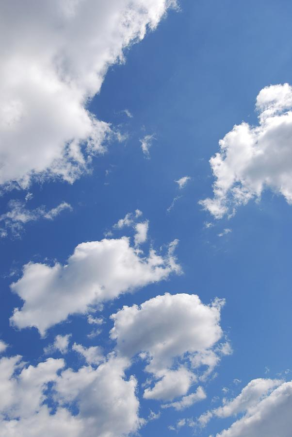 Clouds And Blue Sky by Angie Tirado