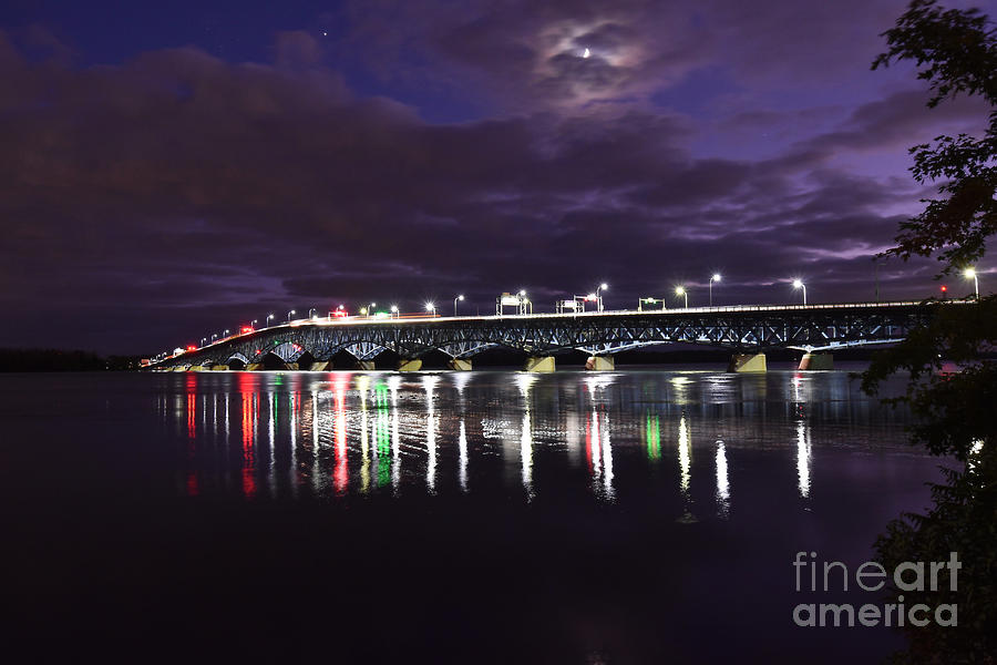Clouds And The Waxing Crescent Moon Over The North Grand Island Bridge by Sheila Lee