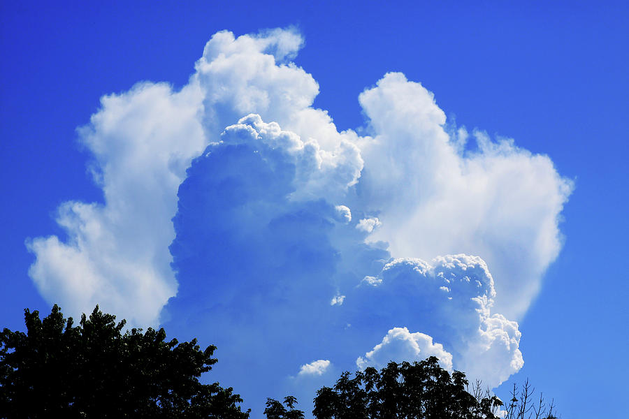 Clouds Photograph - Clouds one by John Lautermilch