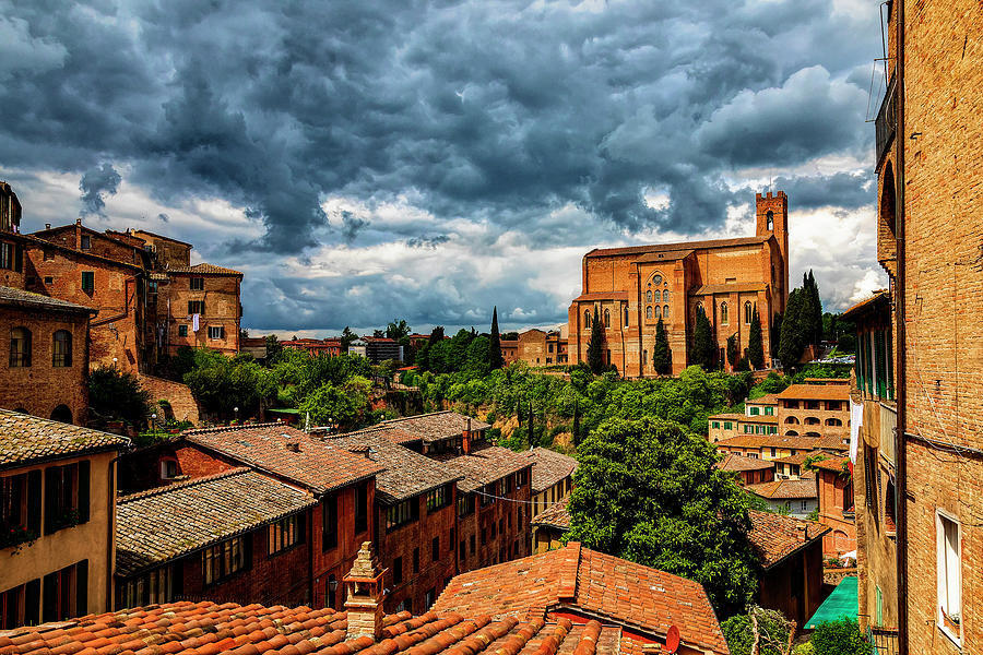 Clouds over Basilica San Domenico in Siena, Italy by Lowell Monke
