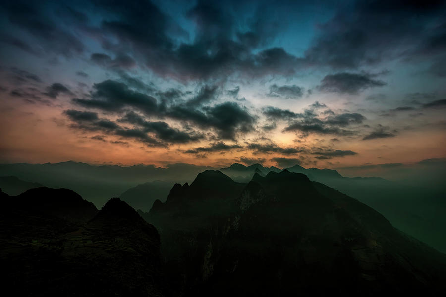 Sunset Photograph - Clouds Over Mountains by Daniel Hagerman