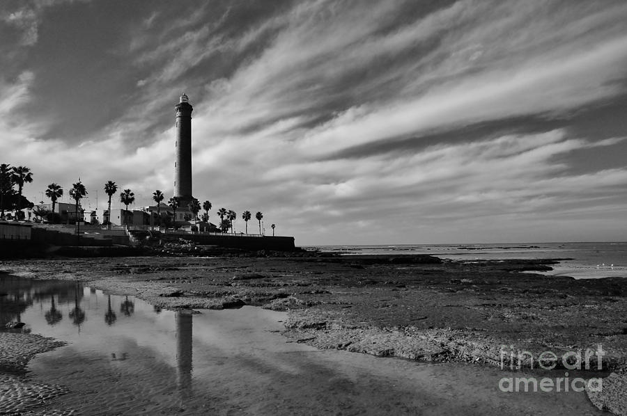 Atlantic Ocean Photograph - Clouds Over The Chipiona Faro by Tony Lee