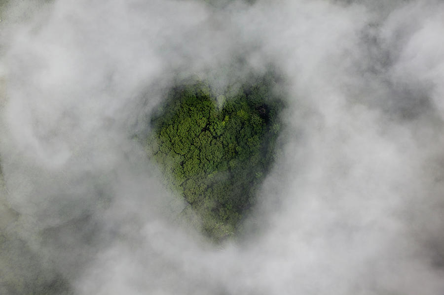 Clouds With Heart-shaped Opening Photograph by Thomas Jackson