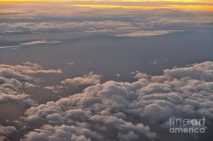 Cloudscape at sunset from an Airplane by Angelo DeVal