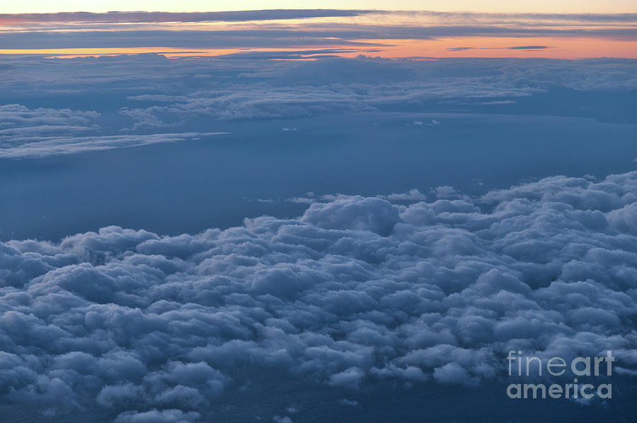 Cloudscape at Twilight from an Airplane by Angelo DeVal