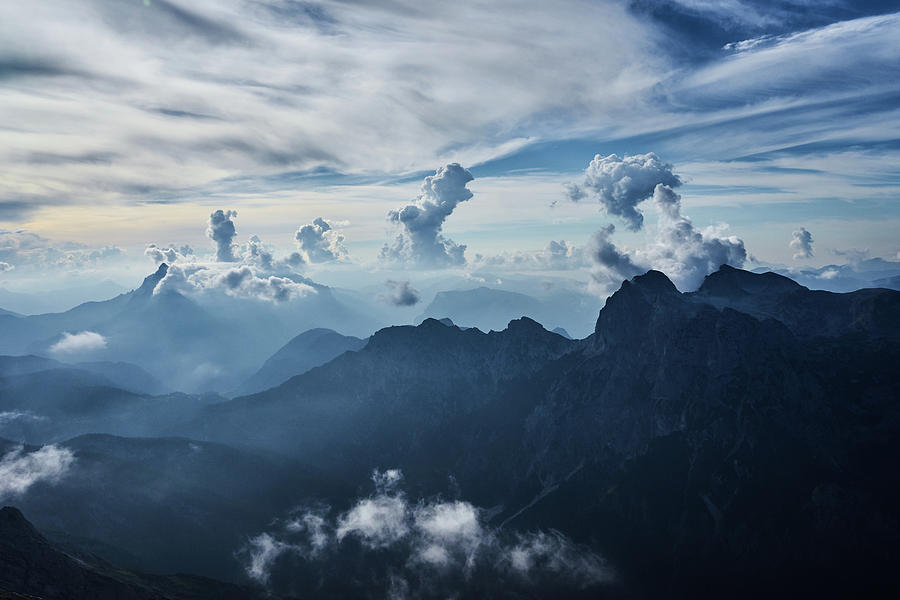 Adventure Photograph - Moody Cloudy Mountains With A Lot Of Contrast And Shadows And Clouds by Lukas Kerbs
