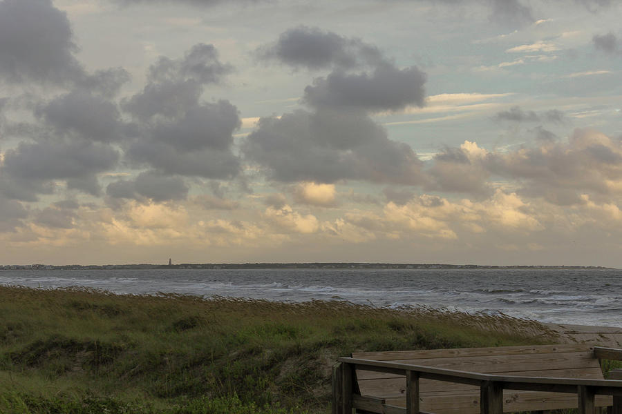 Cloudy Skies Over The Beach Photograph