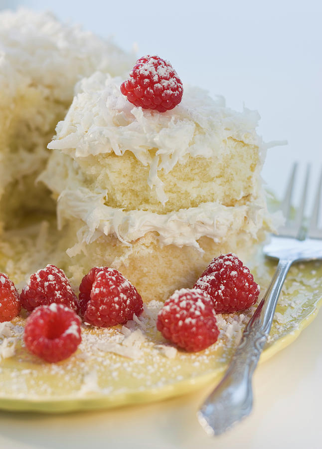 Coconut Cake With Raspberries Photograph by Tom Grill