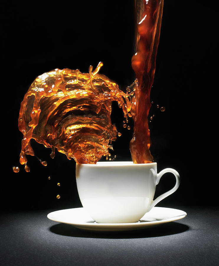Coffee Being Poured Into Cup Splashing Photograph by Henrik Sorensen