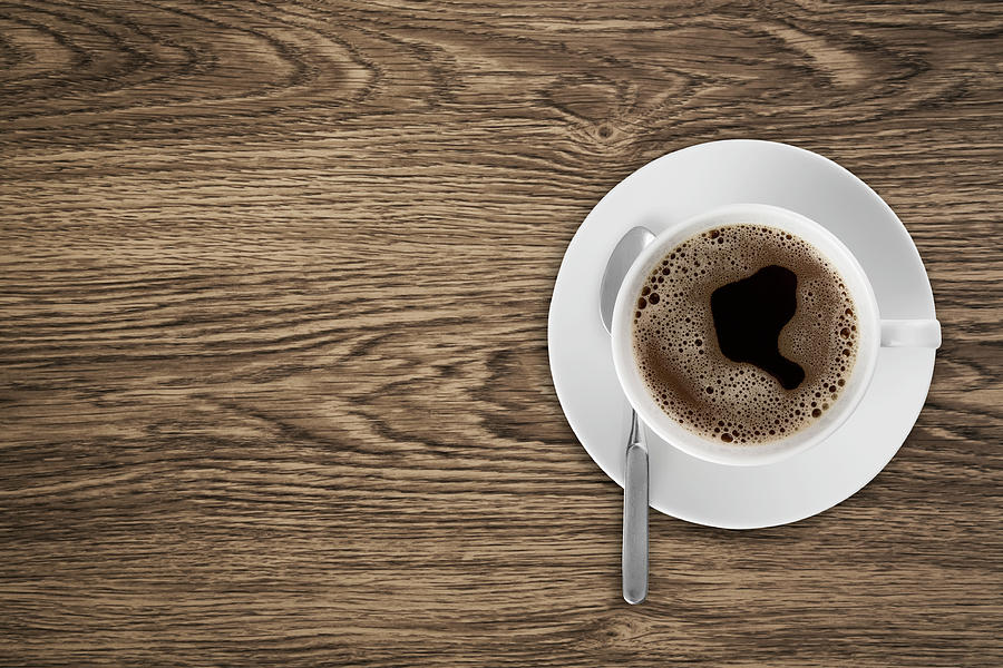 Coffeecup With Coffee In It On A Wooden Photograph by Daneger